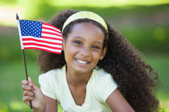 Young girl celebrating independence day in the park Royalty Free Stock Photos