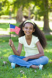 Young girl celebrating independence day in the park Stock Photography