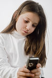 Young girl and cell phone Royalty Free Stock Photography
