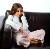 Young girl and cell phone Stock Photos