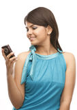 Young girl with the cell phone Stock Photography