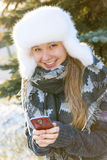 Young girl with cell phone in winter Stock Image