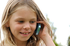 Young girl with cellphone Stock Image