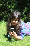 Young girl  with cellphone Stock Photography