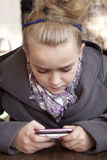 Young girl with cellphone royalty free stock photo