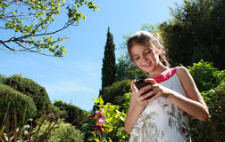 Young girl with a cellphone Stock Photos