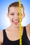 Young girl with centimeter Stock Image