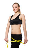 Young girl with centimeter in dieting concept Royalty Free Stock Photography