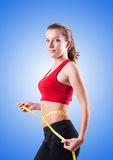 Young girl with centimeter in dieting concept Royalty Free Stock Images