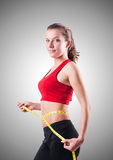 Young girl with centimeter in dieting concept Stock Photos