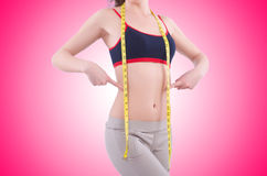 Young girl with centimeter in dieting concept Royalty Free Stock Image