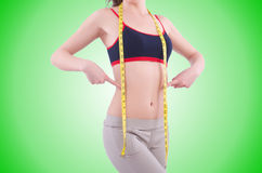 Young girl with centimeter in dieting concept Stock Image