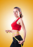 Young girl with centimeter in dieting concept Royalty Free Stock Photos