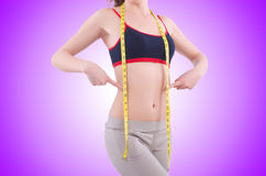The young girl with centimeter in dieting concept Stock Photography