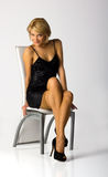 Young girl on the chair in studio Royalty Free Stock Photo