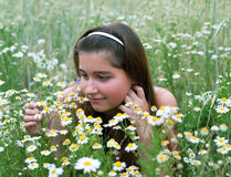 Young girl on chamomiles Stock Image