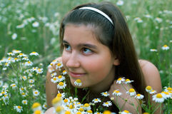 Young girl on chamomiles field Stock Photography