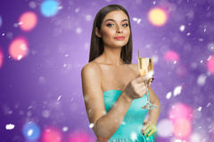 Young girl with champagne indoors Royalty Free Stock Images