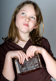 Young girl with change purse Royalty Free Stock Image