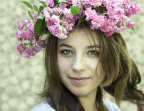 Young girl in a chaplet from  roses Royalty Free Stock Photography