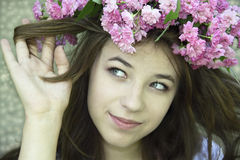 Young girl in a chaplet from  roses Royalty Free Stock Images