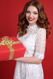 Young girl with charming smile,with present Stock Images