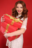Young girl with charming smile,with present Royalty Free Stock Photo