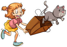 A young girl chasing the cat Stock Image