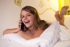 Young girl chatting on the phone with her friend , shallow depth Royalty Free Stock Photos