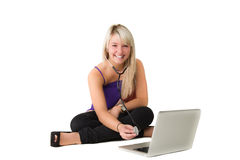 Young girl checking her laptop Stock Images