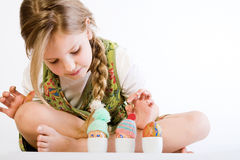 Young girl checking her painted eggs Royalty Free Stock Images