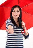 Young girl checks if it rains Stock Images