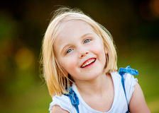 A young girl with a cheerful expression - outdoors Royalty Free Stock Photos