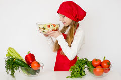 Young girl chef going to prepare a salad isolated Stock Photo