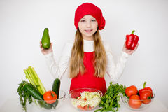 Young girl chef going to prepare a salad isolated Stock Image