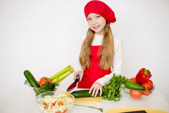 Young girl chef going to prepare a salad isolated Stock Photos