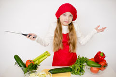 Young girl chef going to prepare a salad isolated Royalty Free Stock Photo