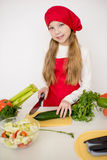 Young girl chef going to prepare a salad isolated Royalty Free Stock Image