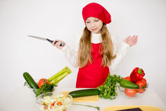 Young girl chef going to prepare a salad isolated Stock Photography