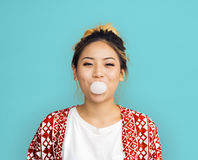 Young Girl Chewing Bubble Gum Concept Stock Photography
