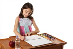 Young Girl / Child Drawing with Pencils Royalty Free Stock Photos