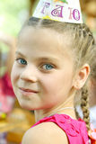 Young girl at a child's birthday party Stock Images