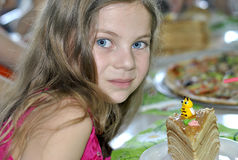 Young girl at a child's birthday party Royalty Free Stock Image