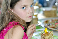Young girl at a child's birthday party Stock Photo