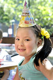 Young girl at a child's birthday party Royalty Free Stock Images