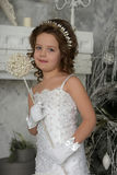 Young girl child at a wedding. Young white girl in a smart dress royalty free stock photography