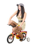 Young girl on a children's bicycle Royalty Free Stock Photography