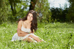 Young girl chilling in green park outdoors royalty free stock photos