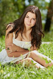 Young girl chilling in green park outdoors stock image