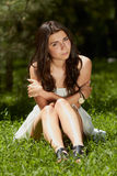 Young girl chilling in green park outdoors Stock Photography